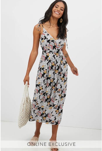 BUTTON FRONT HALTER NECK JUMPSUIT
