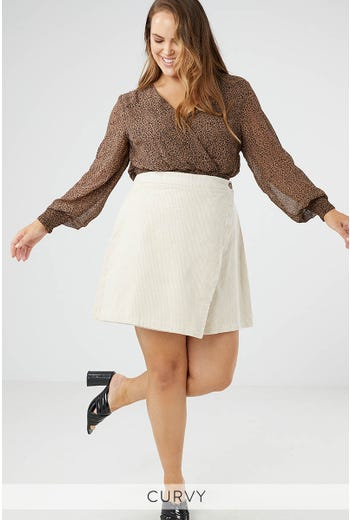 STOCKHOLM BUTTON WRAP SKIRT